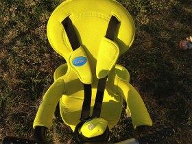Le tricycle Smart Trike est équipé d'un harnais de sécurité.
