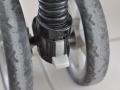bouton pour bloquer les roues avant de la poussette Cocoon Citysport Graco