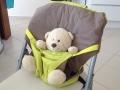 Voici le Siège nomade Babytolove mis en place sur une chaise.